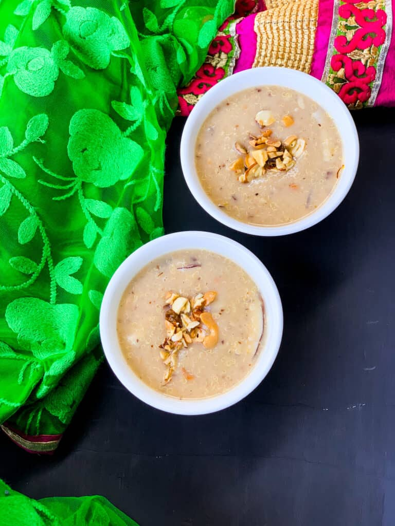2 bowls of kheer with nuts on top.