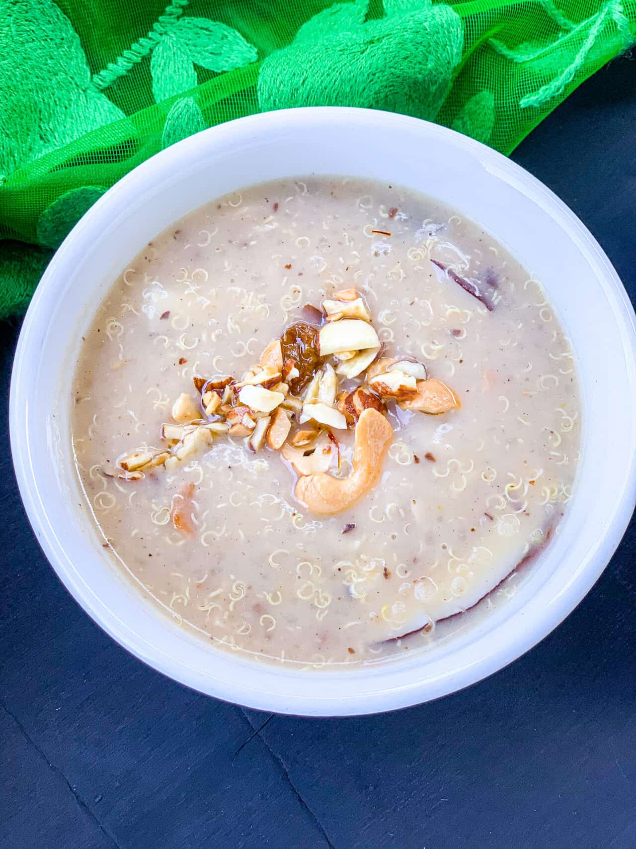 A picture of kheer in a white bowl.