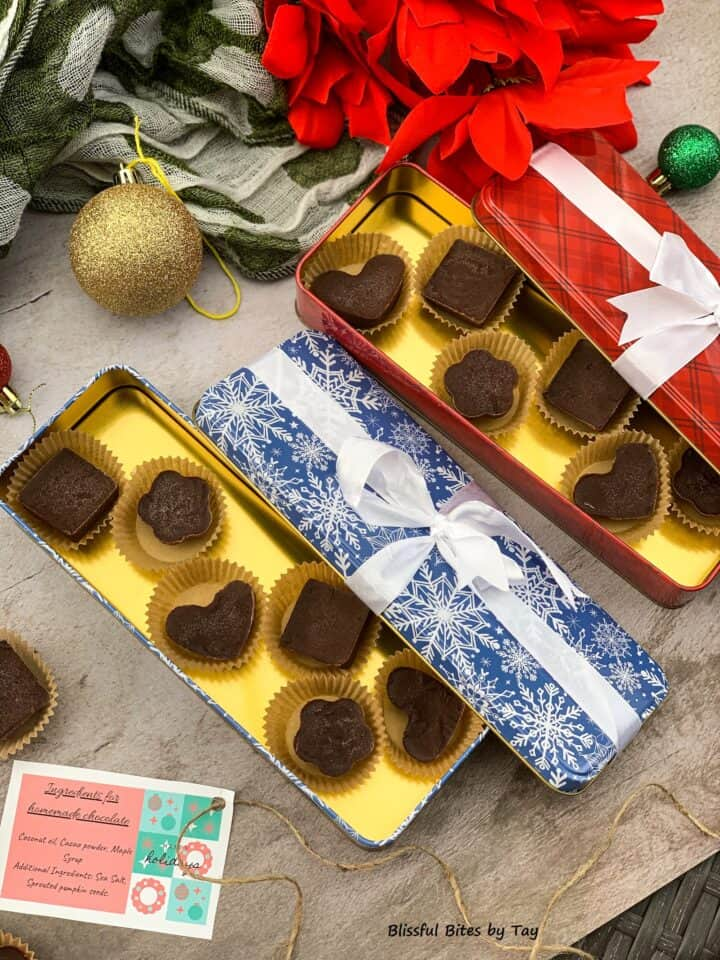 Homemade chocolate in gift boxes in fancy shapes.