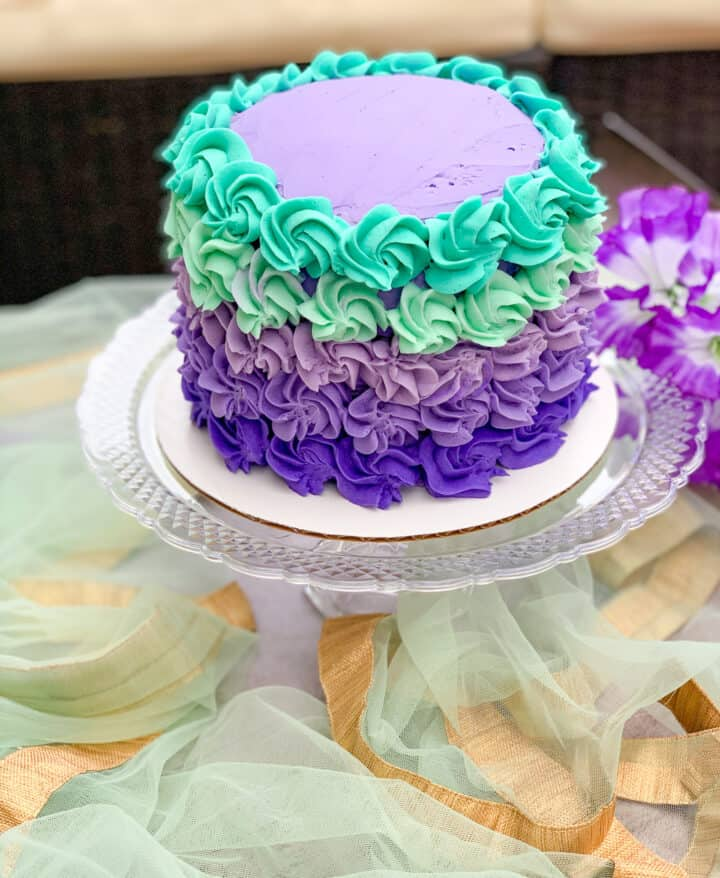 A Rosette cake in purple and teal colors.